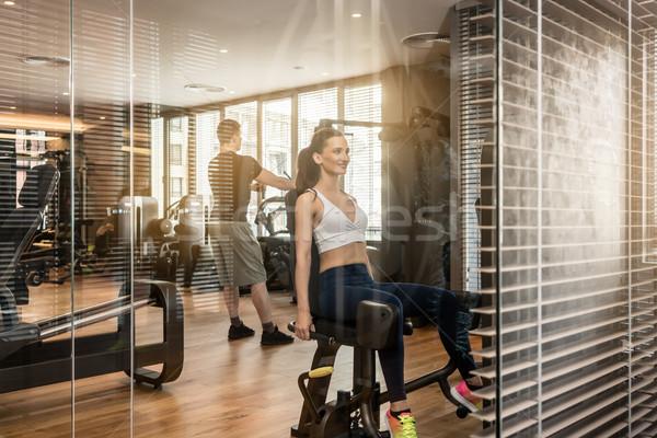 Vonzó nő ül gép testmozgás fenék vonzó Stock fotó © Kzenon