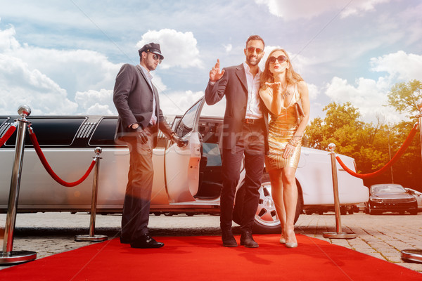 Couple arriving with limousine walking red carpet Stock photo © Kzenon