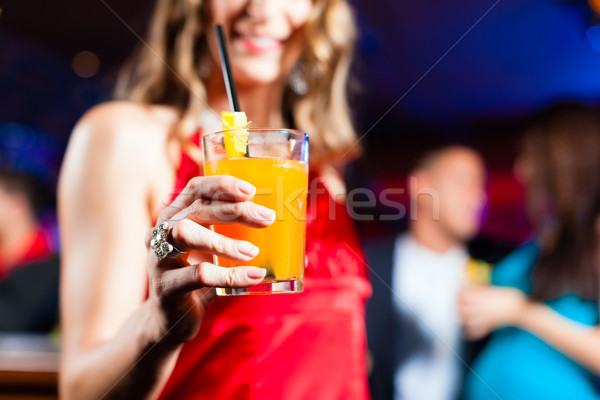 Woman with cocktail in bar or club Stock photo © Kzenon
