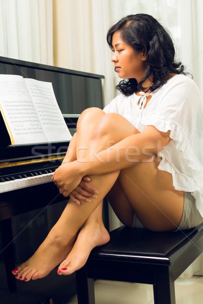 Asian woman sitting at the piano Stock photo © Kzenon