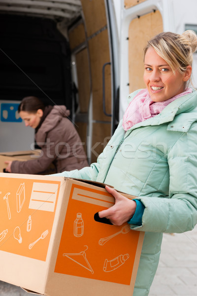 Female friends loading a moving truck Stock photo © Kzenon