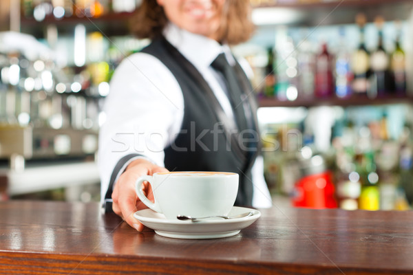Barista making cappuccino in his coffeeshop Stock photo © Kzenon