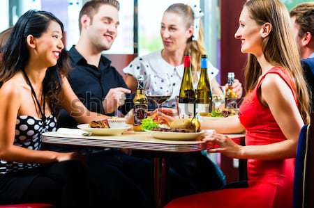 Stock photo: People in American diner or restaurant with wine