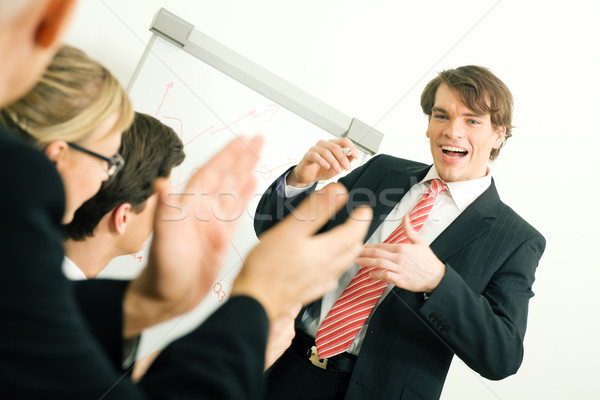 Business presentation: applause Stock photo © Kzenon