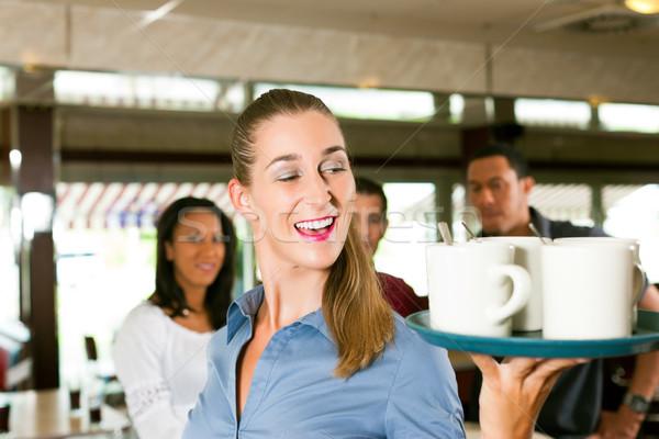 Woman as waitress in a bar or restaurant Stock photo © Kzenon