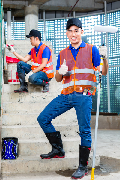 Asian Painter with brush and paint on construction site  Stock photo © Kzenon