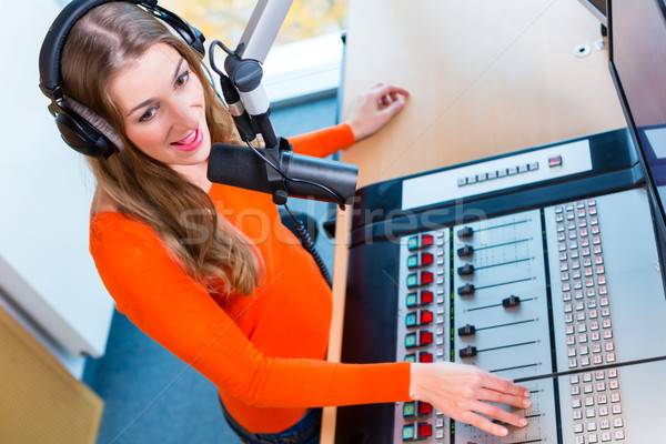 Female radio presenter in radio station on air Stock photo © Kzenon