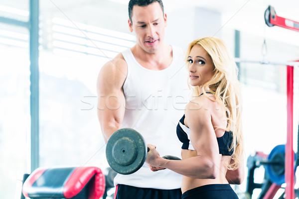 Vrouw gymnasium barbell fitness opleiding Stockfoto © Kzenon