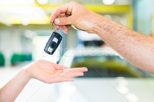 Stock photo: Workshop mechanic handing car to customer