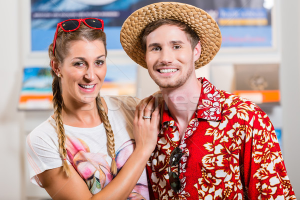 Couple in travel agency Stock photo © Kzenon