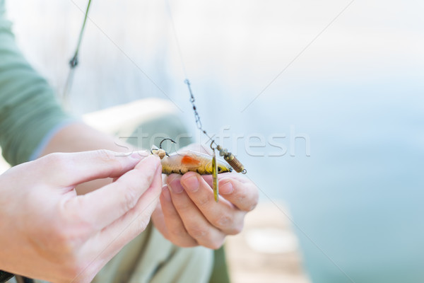 Angler fixing lure at hoof of fishing rod Stock photo © Kzenon