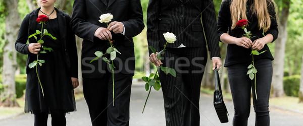 Torso of family on cemetery mourning Stock photo © Kzenon