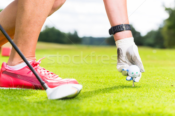 woman putting golf ball on tee, close shot Stock photo © Kzenon