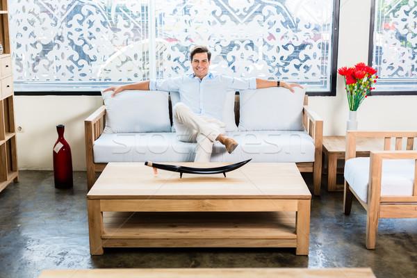 человека сидят диване мебель магазине выставочный зал Сток-фото © Kzenon