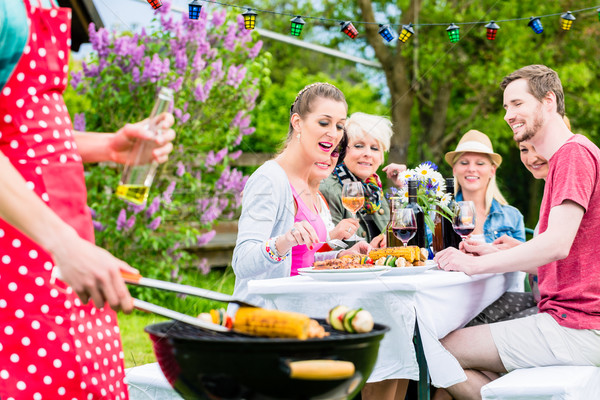 Man grilling meat and vegetables on garden party Stock photo © Kzenon