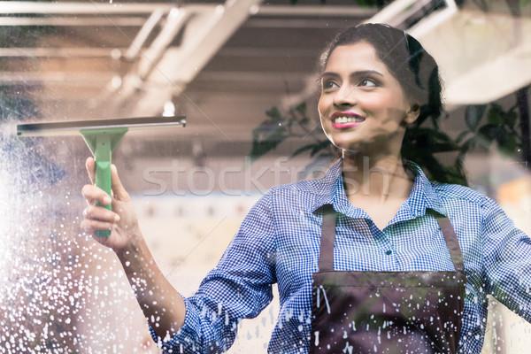Indian employee cleaning windows Stock photo © Kzenon