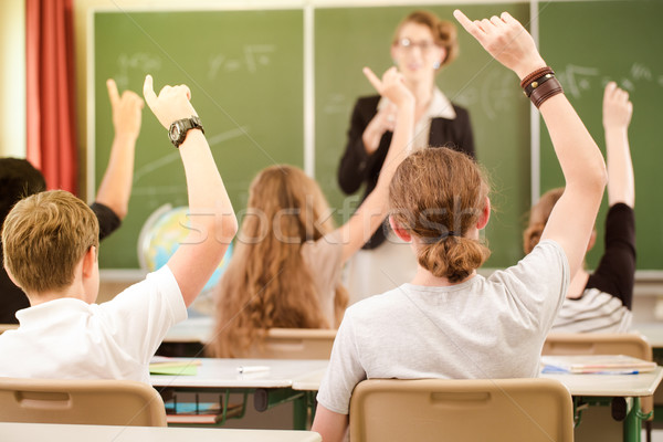 Teacher  in a class of  pupils in school Stock photo © Kzenon