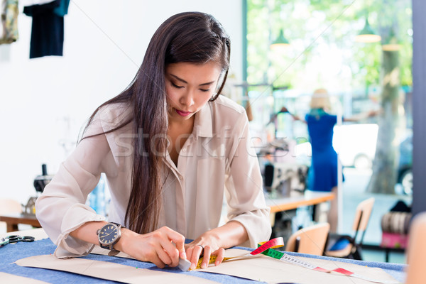 Asian fashion designer woman drafts cut pattern Stock photo © Kzenon