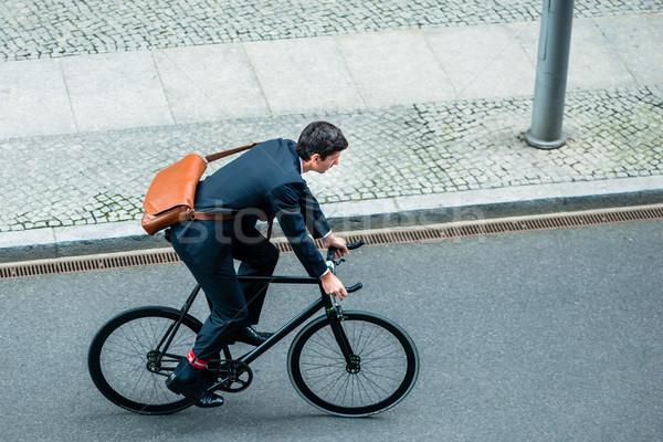 Młody człowiek działalności garnitur jazda konna użyteczność Zdjęcia stock © Kzenon