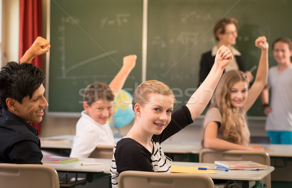 Math teacher standing in front of students who are well prepared Stock photo © Kzenon