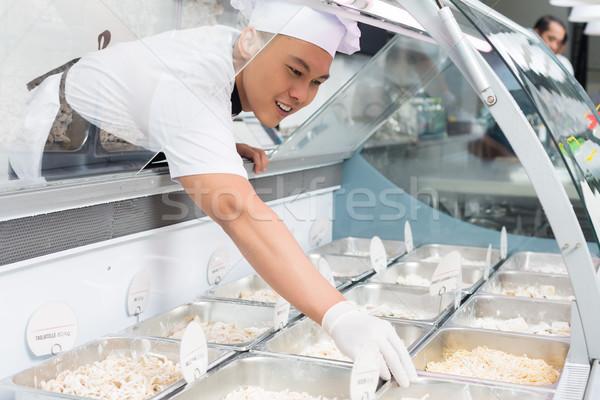 ázsiai szakács étel üveg pult étterem Stock fotó © Kzenon