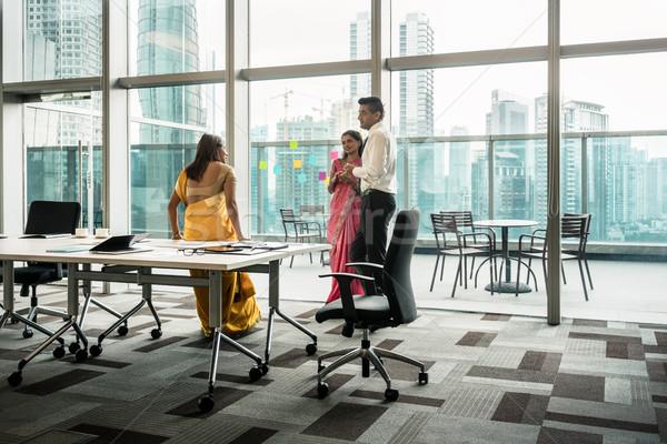 Three Indian employees talking during break in the meeting room Stock photo © Kzenon