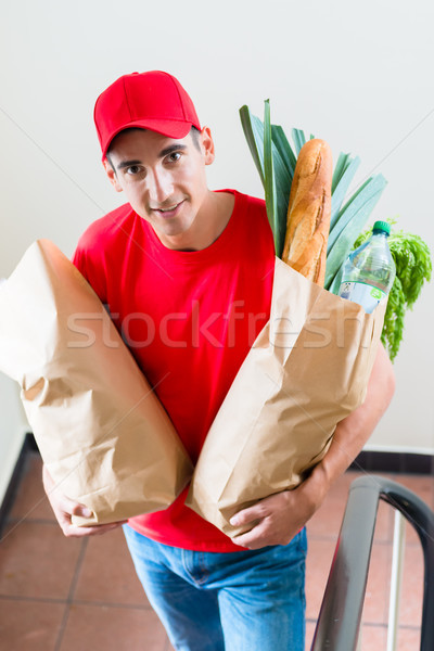 Grocery delivery courier with paper bags of food Stock photo © Kzenon