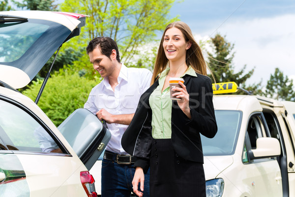 Young businesswoman in front of taxi Stock photo © Kzenon