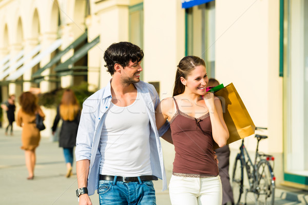 Couple shopping and spending money in city Stock photo © Kzenon