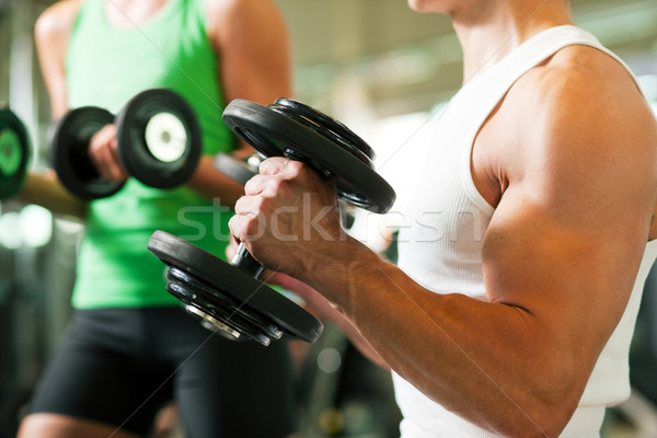 Dumbbell training in gym  Stock photo © Kzenon