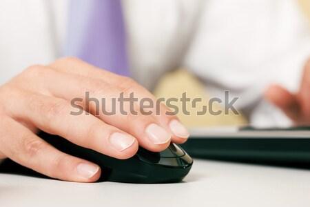 Man using computer mouse Stock photo © Kzenon