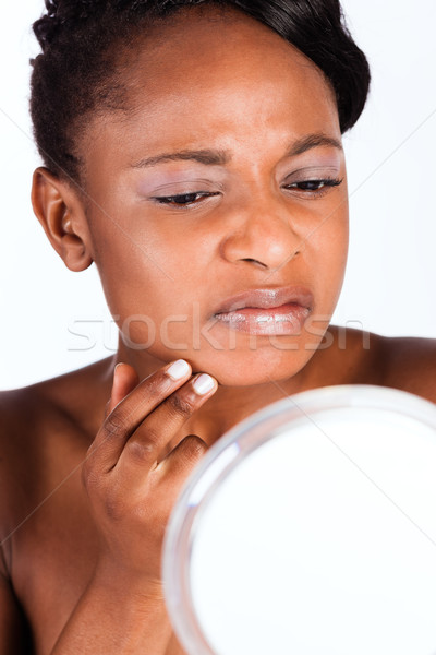 Beautiful African woman in Studio with mirror Stock photo © Kzenon