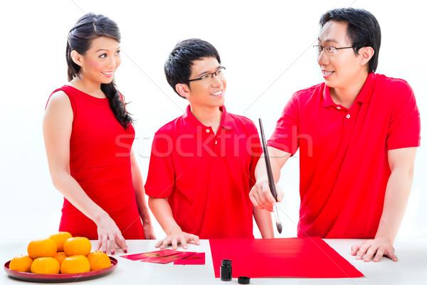 Traditionellen Schriftkunst Freunde Familie feiern Stock foto © Kzenon