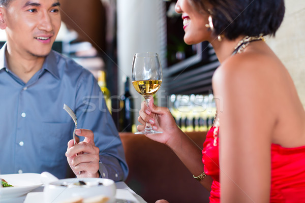 Asian couple fine dining in restaurant Stock photo © Kzenon