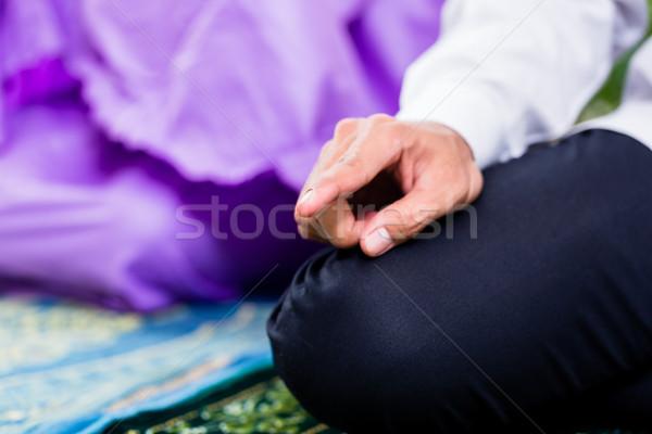 Muslim couple, man and woman, praying at home Stock photo © Kzenon