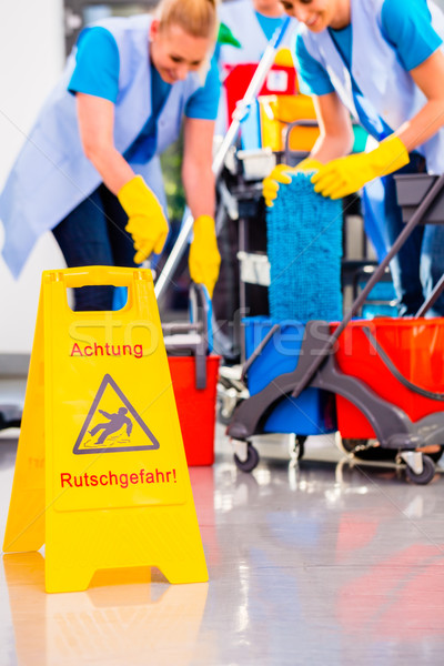 Warning sign on floor in cleaning operation Stock photo © Kzenon