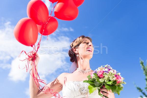 Bride at wedding with read helium balloons Stock photo © Kzenon
