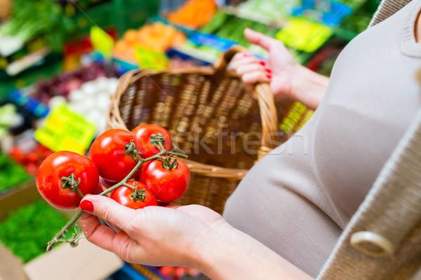 Woman shopping groceries on farmers market Stock photo © Kzenon