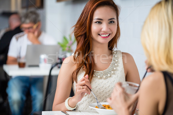 Attractive elegant woman lunching with a friend Stock photo © Kzenon