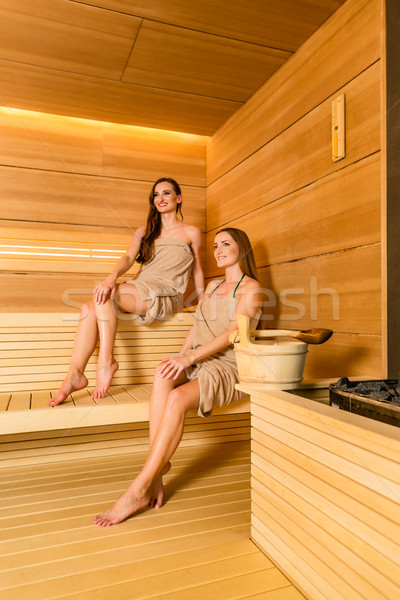 Two female best friends enjoying the therapeutic effect of a dry Stock photo © Kzenon
