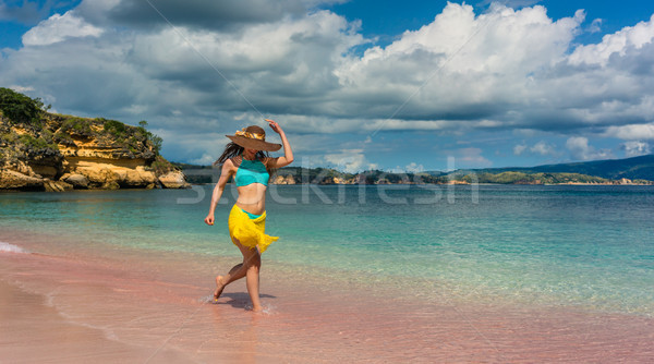 Fashionable young woman enjoying happiness and freedom at tropical beach Stock photo © Kzenon