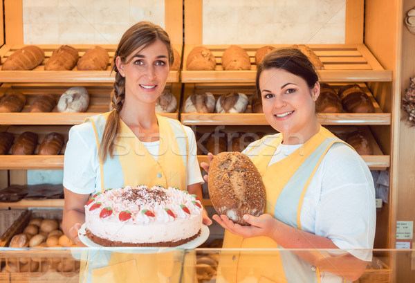 Sales women in bakery with cake and bread Stock photo © Kzenon