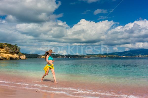 Fashionable young woman enjoying happiness and freedom on a tropical beach Stock photo © Kzenon