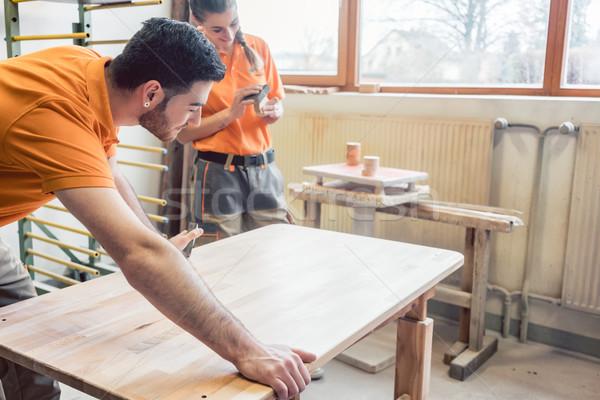 Team oft wo carpenters working on a table Stock photo © Kzenon