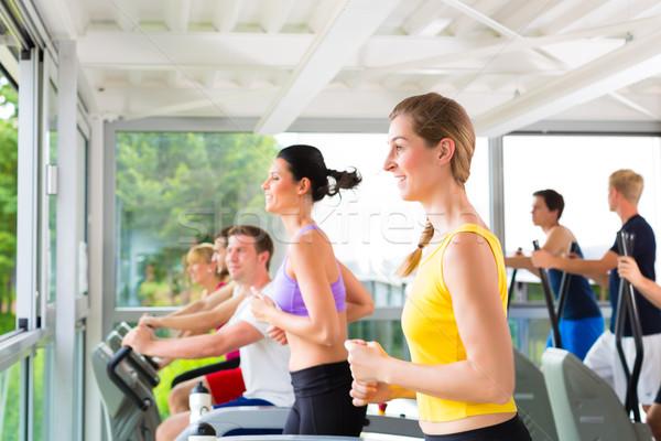 люди спорт спортзал бегущая дорожка работает фитнес Сток-фото © Kzenon