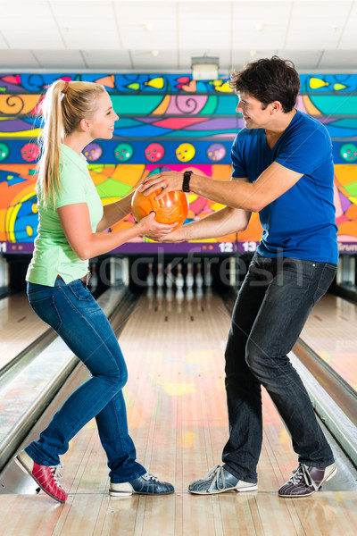 Young people playing bowling and having fun Stock photo © Kzenon