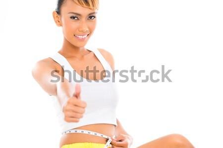 ázsiai nő mér test fogyás fitnessz Stock fotó © Kzenon