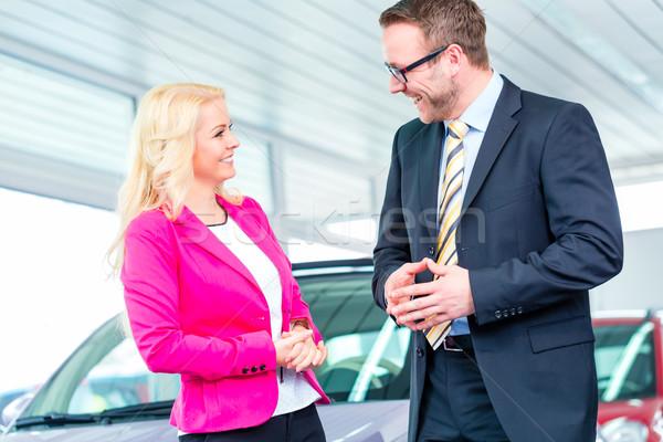 Woman buying new car in dealership Stock photo © Kzenon