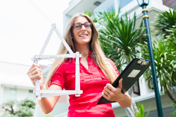 Architect with folding rule in front of house Stock photo © Kzenon