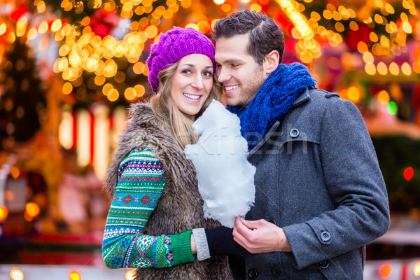 Couple on Christmas market eating cotton candy Stock photo © Kzenon